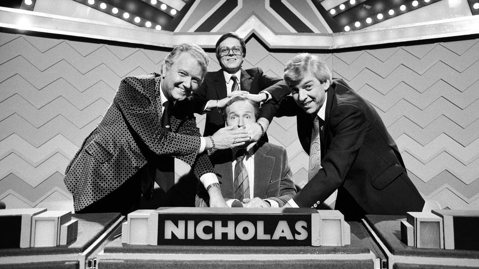 Nicholas Parsons, Tom O'Connor, Derek Batey and Steve Jones taking part in a celebrity edition of Sale of the Century in 1980