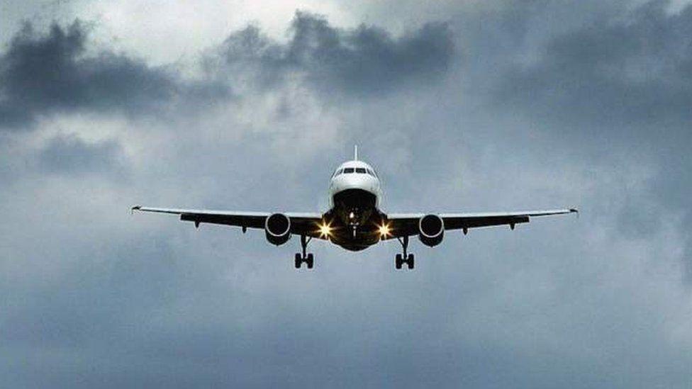 Plane landing at Heathrow Airport