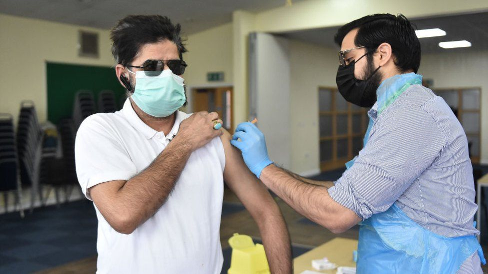 A man from Stoke's City Mosque receives a vaccination against COVID-19 on February 26, 2021 in Stoke.