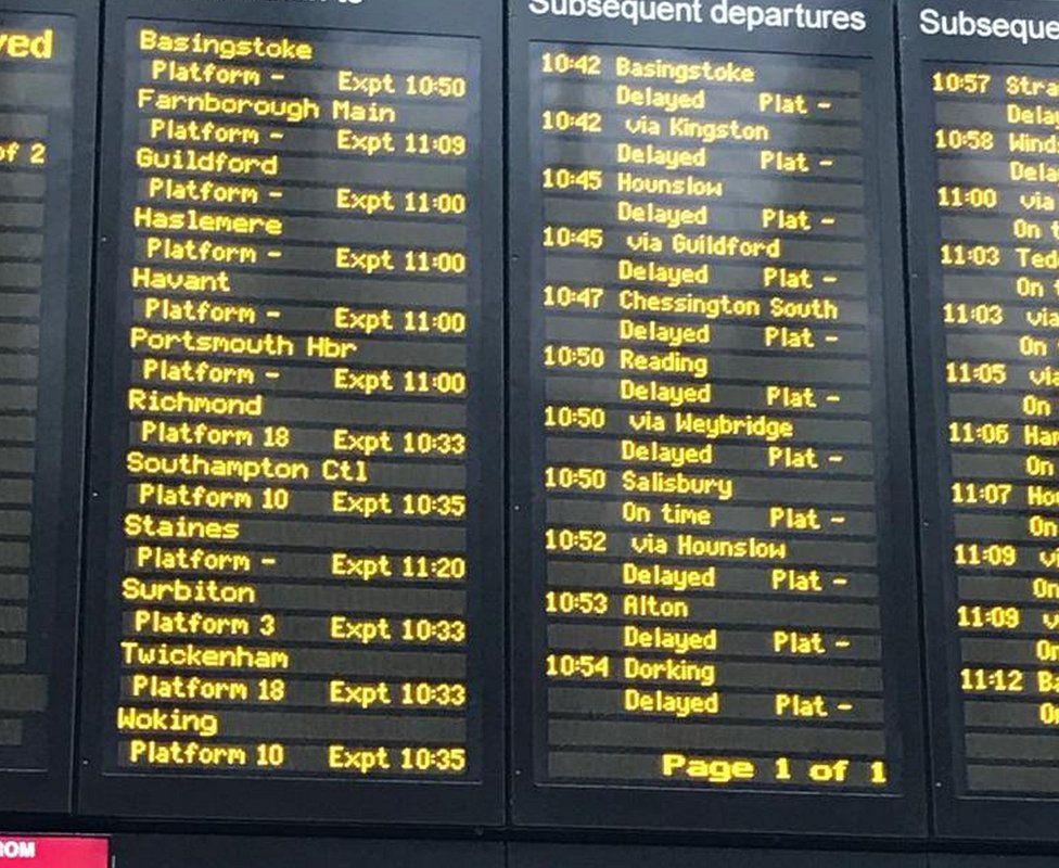 Departure board showing delays