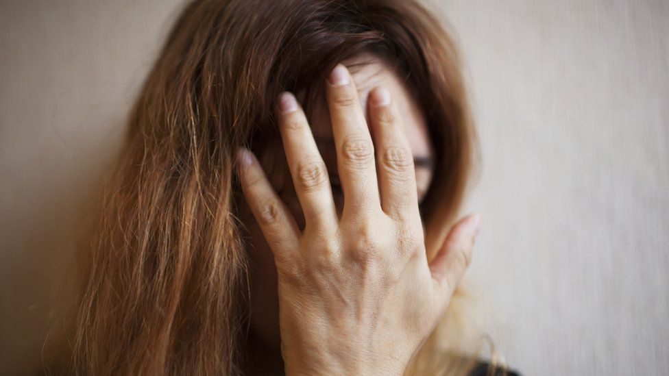 Generic image of a woman covering her face