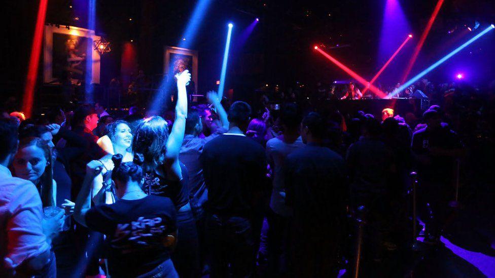 People dancing in a nightclub.