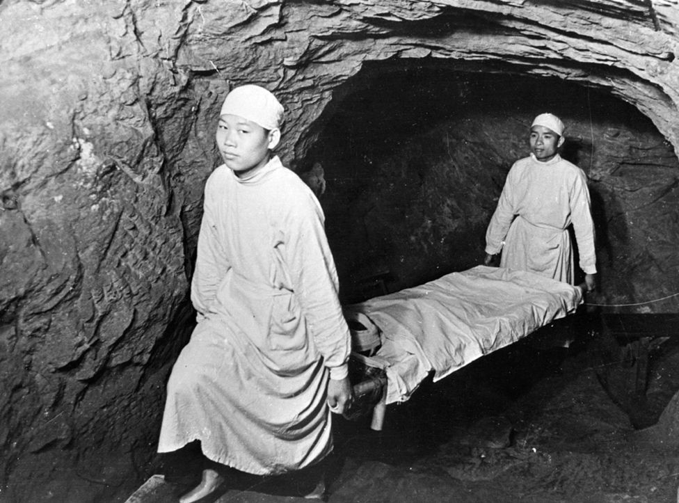 1938: Stretcher bearers at work in the shelters below Chongqing