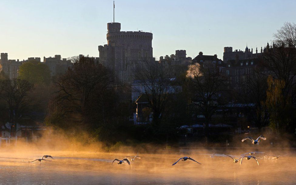 First light rises over Windsor Castle seen from across the River Thames on the Day of Prince Philip, The Duke of Edinburgh's funeral on April 17, 2021 in Windsor, England.