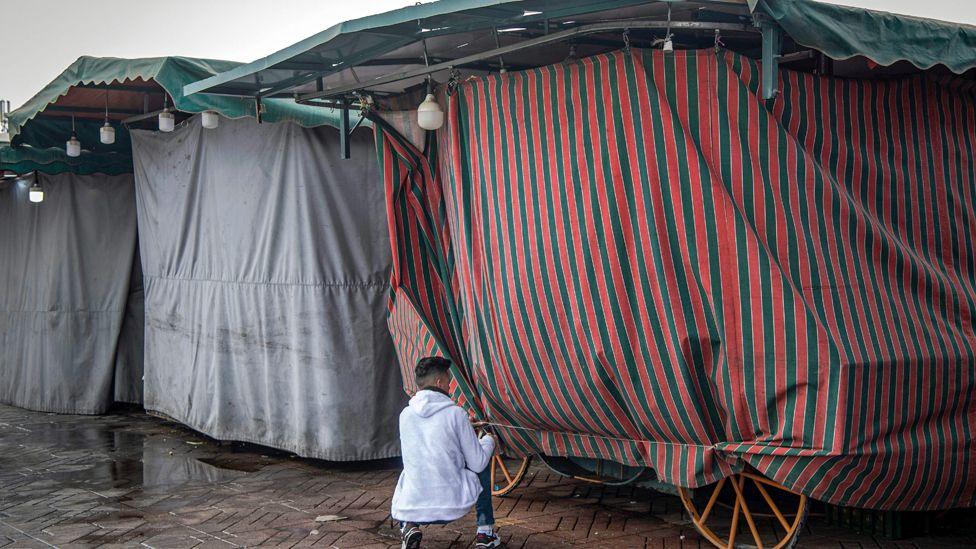 A vendor shuts his stall in Marrakesh, Morroco - Monday 16 March 2020