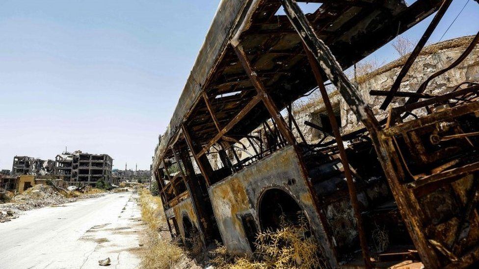 A burnt out bus in Aleppo, Syria