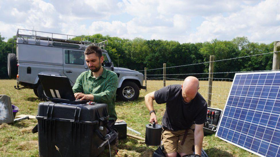 Stephen Hicks installing monitoring equipment