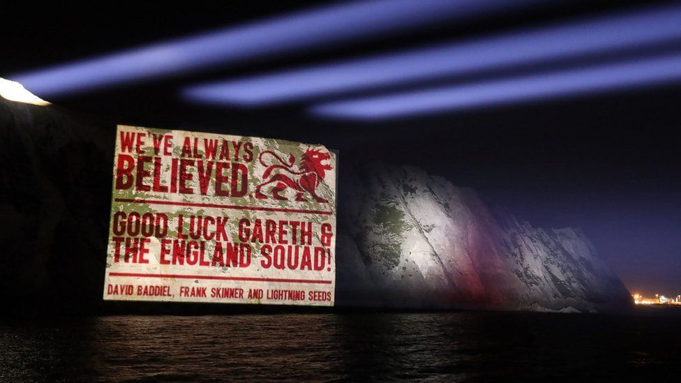 A good luck message from David Baddiel, Frank Skinner and the Lightning Seeds, writers of the song Three Lions, projected onto the White Cliffs of Dover