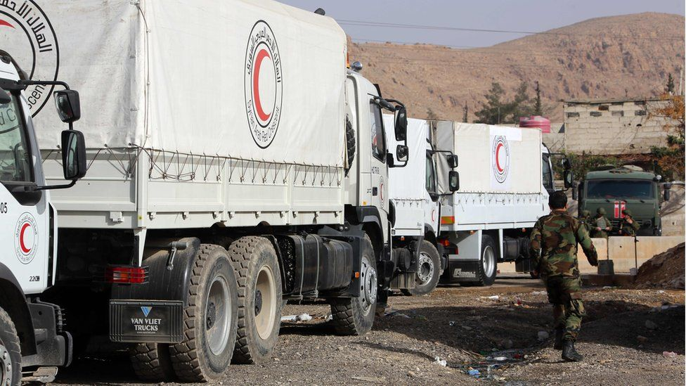 Trucks belonging to the International Committee of the Red Cross (ICRC) are parked on the outskirts of rebel-held Eastern Ghouta, 8 March 2018