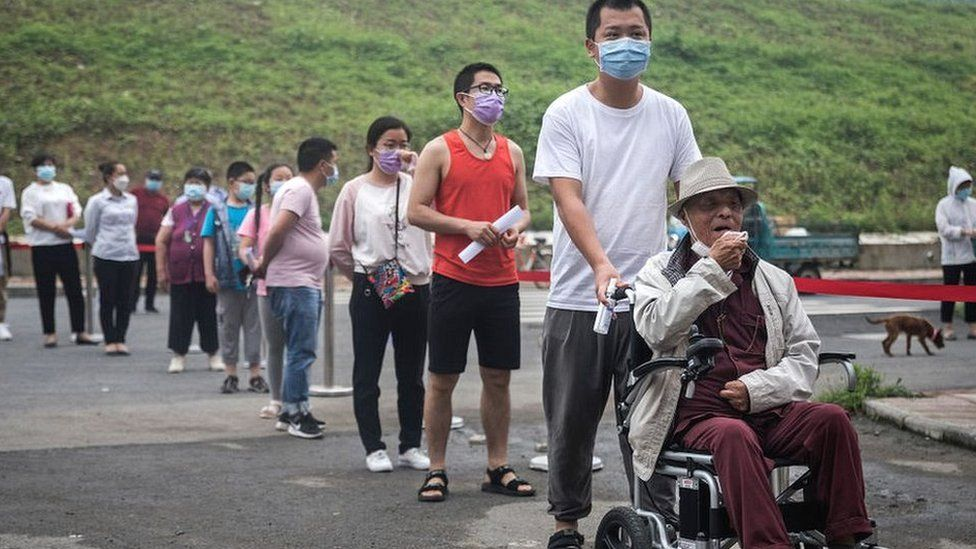 Wuhan residents line up for testing