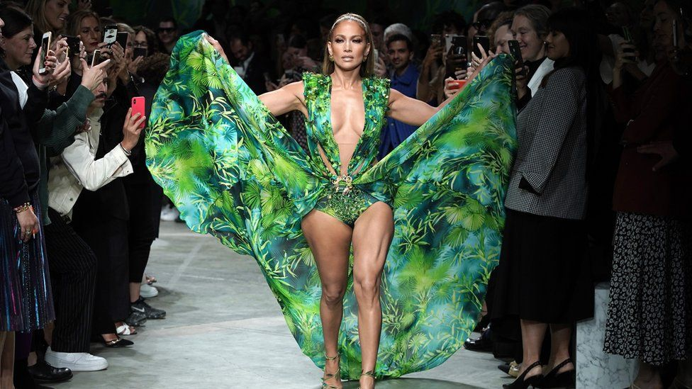 Jennifer Lopez, 50, closing the show at Versace in a recreation of her iconic green dress