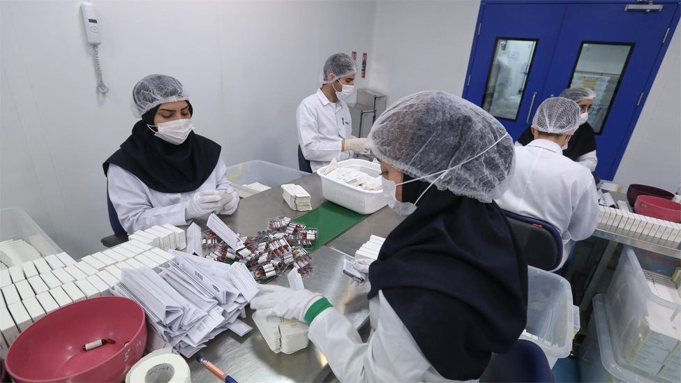 Pharmaceutical factory workers package Metoprolol tablets at the Actoverco plant in Karaj, Iran (18 February 2020)