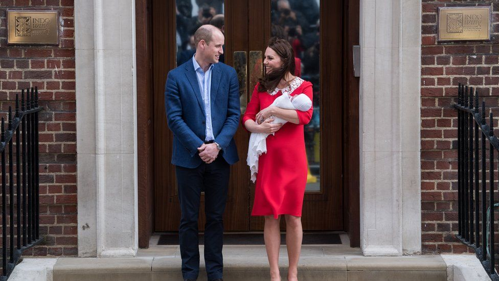 The Duke and Duchess of Cambridge holding their newborn son
