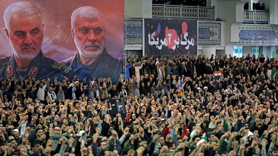 Image shows Iranians gathered for Friday prayers in the capital Tehran, under portraits of Qasem Soleimani