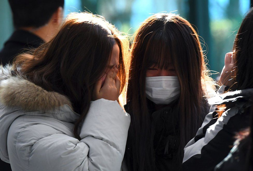 Tearful fans gather to visit the mourning altar for Kim Jong-Hyun, a 27-year-old lead singer of the massively popular K-pop boyband SHINee, at a hospital in Seoul on 19 December 2017.