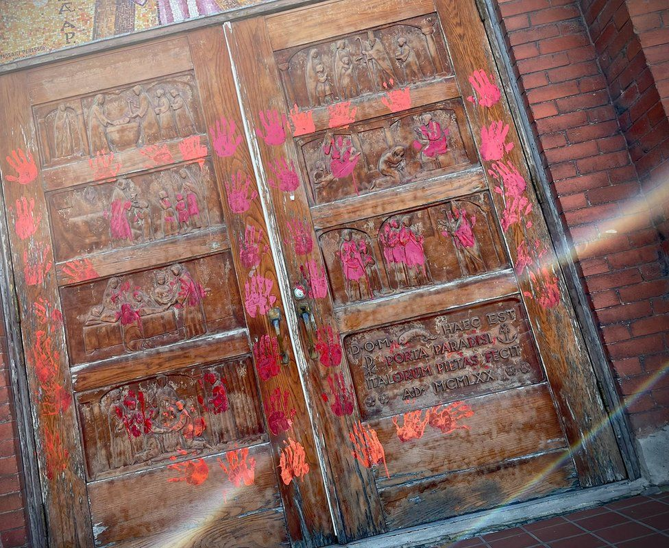 Doors of a Calgary church daubed with paint