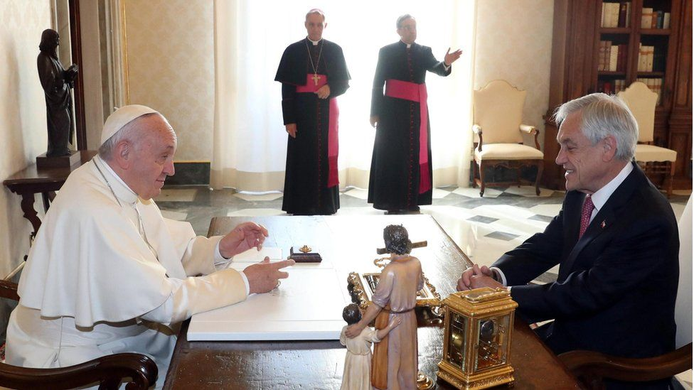 Chile's President Sebastian Pinera (R) listens to Pope Francis (L) as the pontiff receives him in a private audience at the Vatican, 13 October 2018