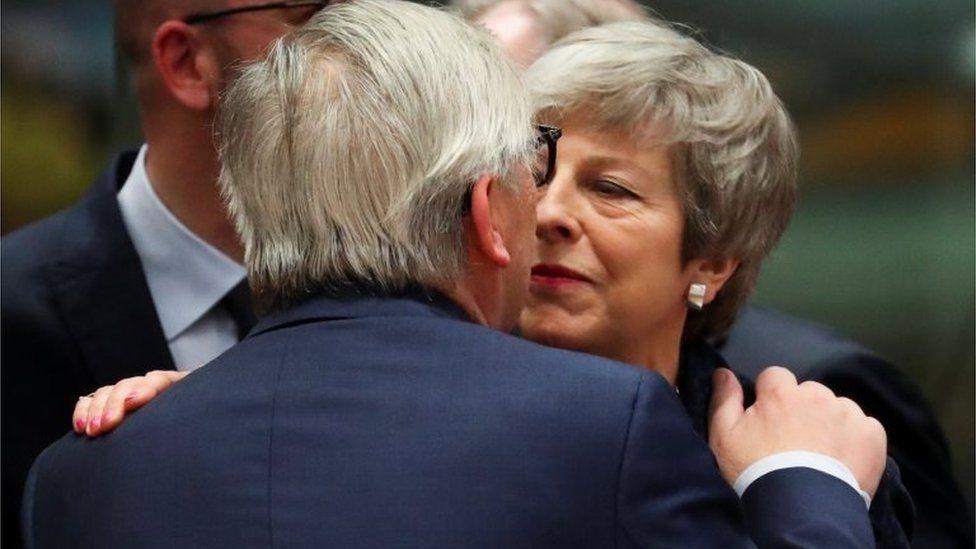 Theresa May greeting Jean-Claude Juncker