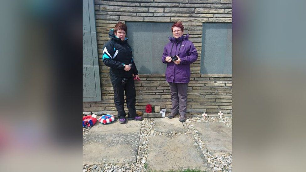 Barbara Royles (in purple) and her sister Mandy Perkins recently visited the Falkland Islands to pay their respects to their brother