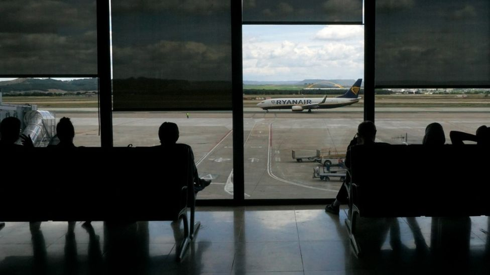 Stock image of people waiting at an airport