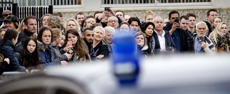 People gather at the High security courthouse, in Schiphol, Amsterdam, on March 12, 2018 for the Holleeder trial