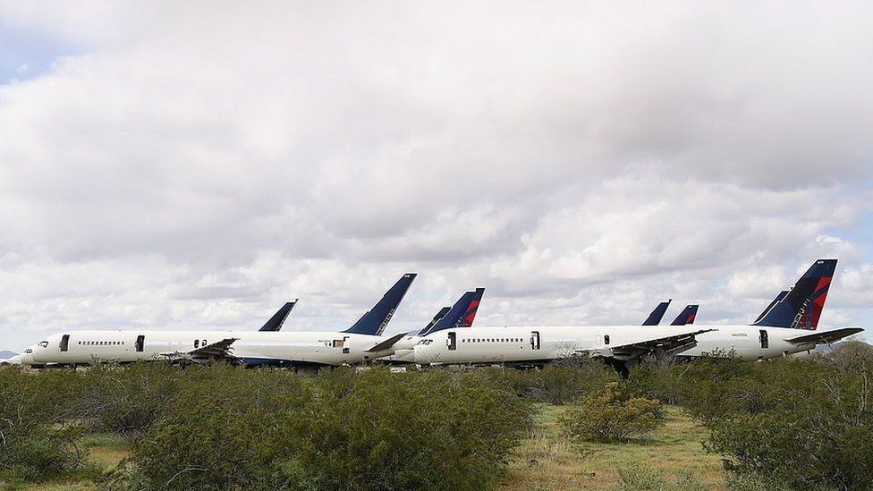 Decommissioned and suspended commercial aircrafts are seen stored in Pinal Airpark yesterday
