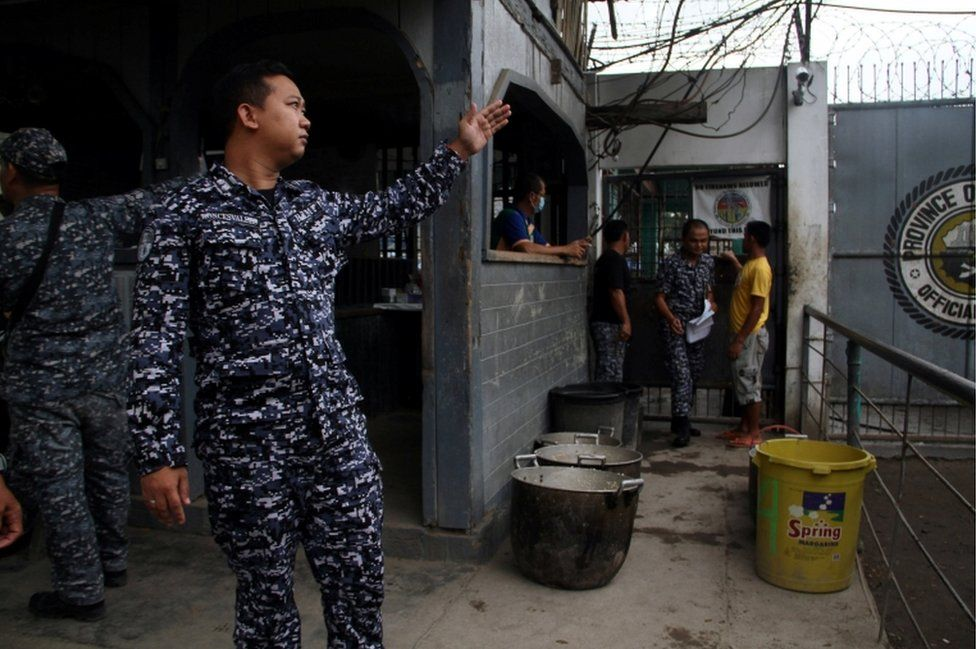 A prison personnel gestures during an interview following the escape of more than 150 inmates after gunmen stormed a prison in North Cotabato province, southern Philippines.