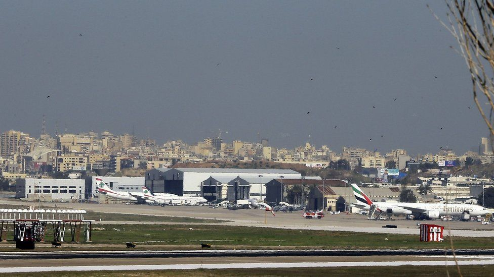 A general view shows a flock of birds flying near the runway at Beirut International airport in the Lebanese capital on 12 January
