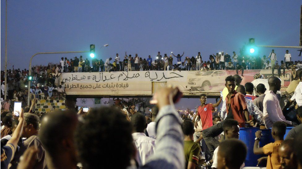 "The banner reading: ""Freedom, peace and justice"" at a sit-in at the military HQ in Khartoum, Sudan - Sunday 7 April 2019"