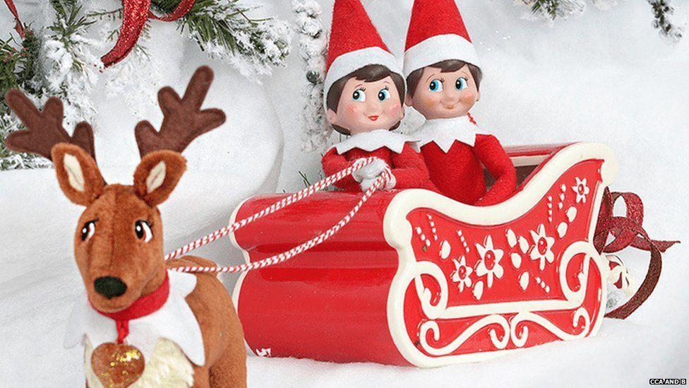 Elf on a Shelf in a sleigh