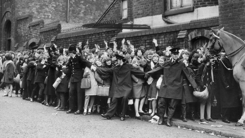 A queue of fans wait to see The Beatles