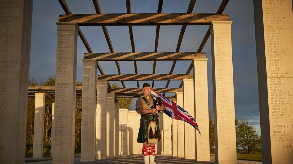 British Piper Steve Black plays at sunrise to mark the 77th anniversary of D-Day at the British Normandy Memorial on Sunday