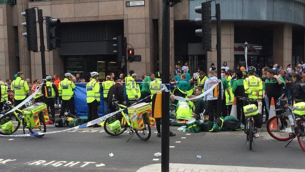 A runner is treated by paramedics