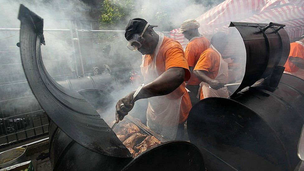 Street food chefs cook jerk chicken at the Notting Hill Carnival 2011