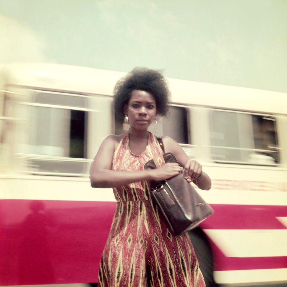 Woman holding a shoulder bag