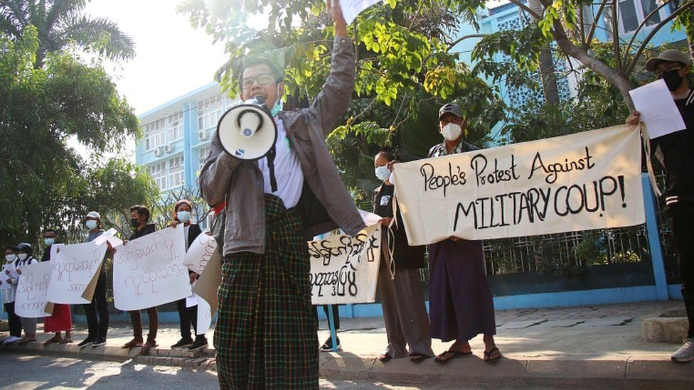 People protest on the street against the military after Monday's coup, outside the Mandalay Medical University in Mandalay, Myanmar February 4, 2021