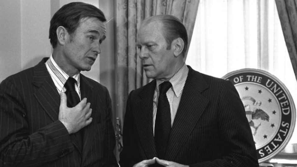 George H Bush, who was Republican National Chairman, chats with Vice-president Gerald Ford in Washington - 18 December 1973