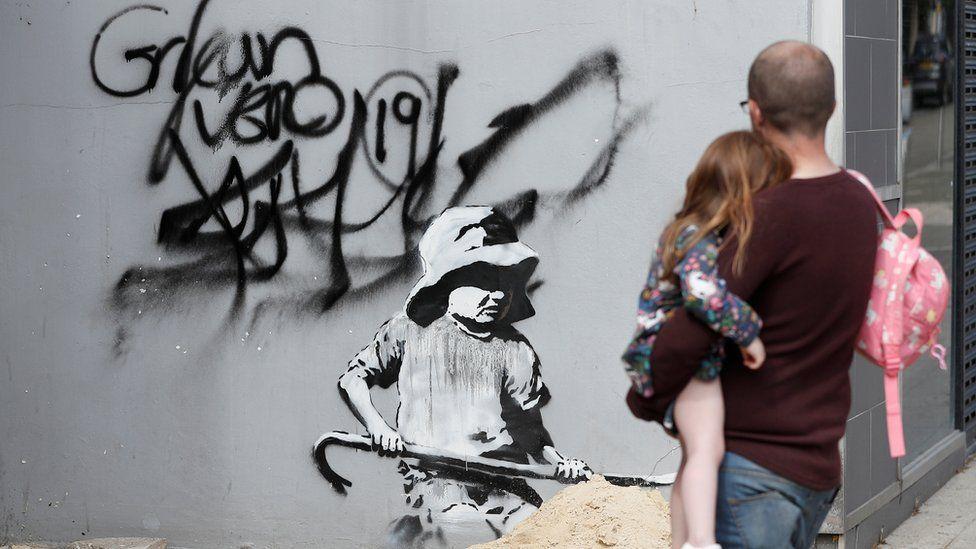 Artwork believed to be created by Banksy is seen in Lowestoft