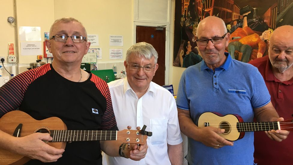 John with members of a ukulele band at his project in Maesteg