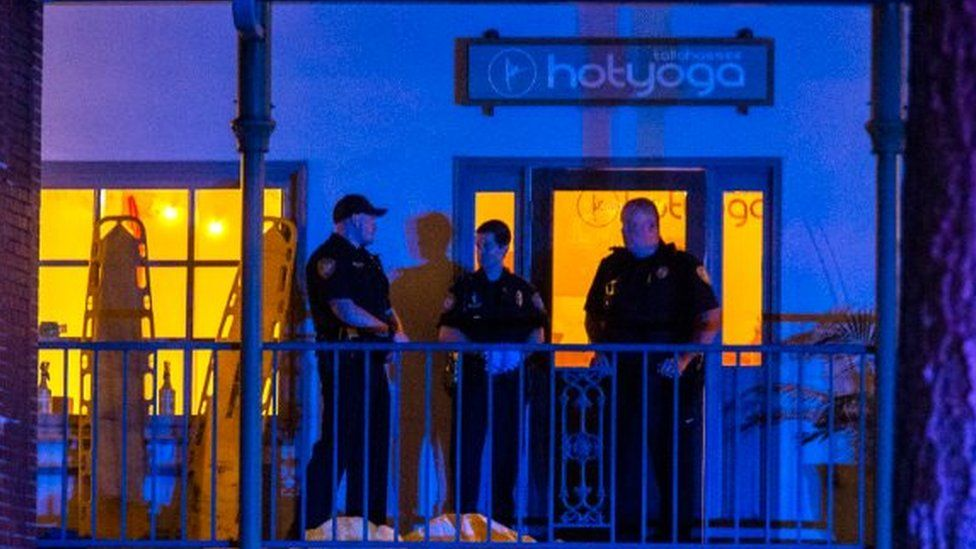 Tallahassee Police officers are stationed outside the HotYoga Studio