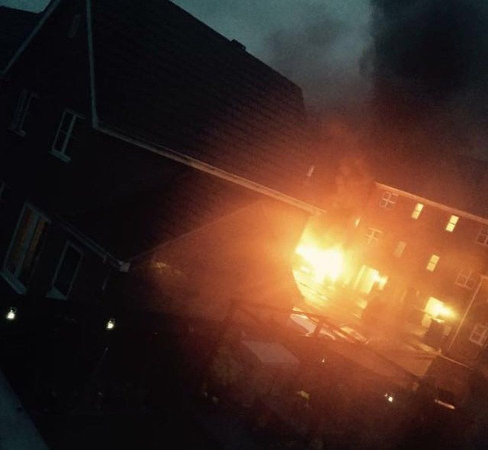 Picture of the blaze taken from a window nearby