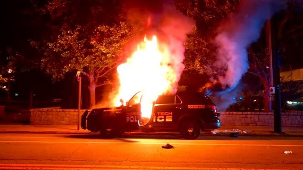 A police car was set ablaze by protesters at Georgia Tech