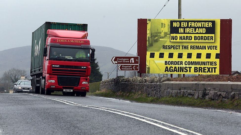 "A sign calling for ""no hard border"" between the Republic of Ireland and Northern Ireland"