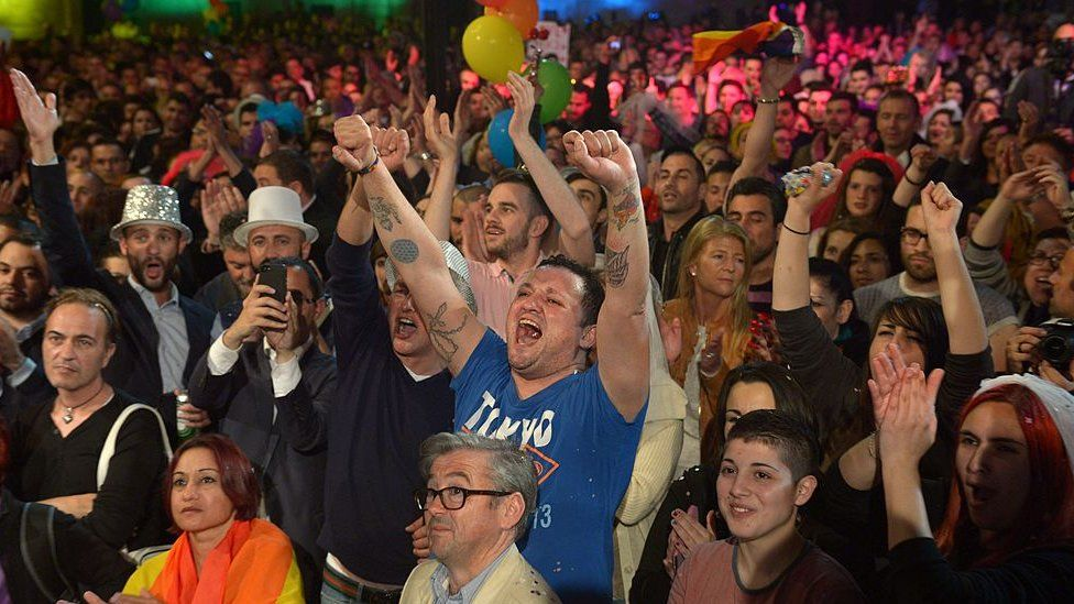 People celebrate in Saint George's Square after the Maltese parliament approved a civil unions bill in Valletta on 14 April 2014