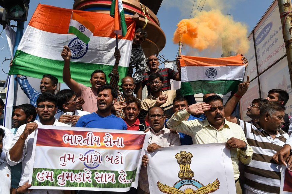 Indian residents in Ahmedabad on 26 February 2019 celebrate following an Indian Air Force (IAF) strike launched on a Jaish-e-Mohammad (JeM) camp in Pakistan.
