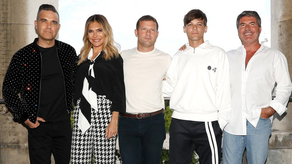 L to R: Robbie Williams, Ayda Field, Dermot O'Leary, Louis Tomlinson and Simon Cowell