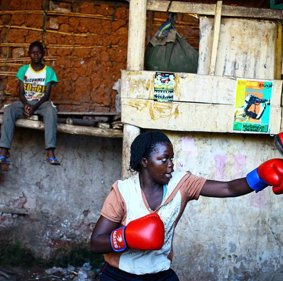 A female boxer training in Uganda