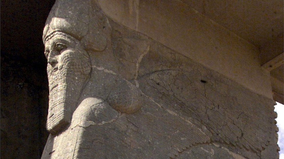 Ancient statue of winged bull at Nimrud, Iraq, pictured in 2001