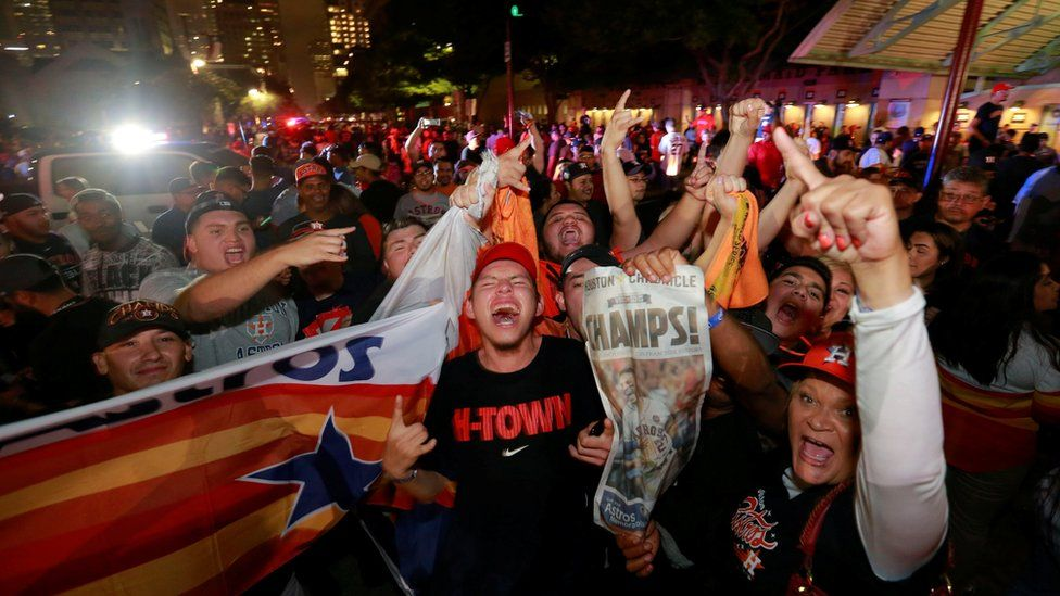 Houston Astros fans celebrate after winning the World Series against the Los Angeles Dodgers outside Minute Maid Park in Houston