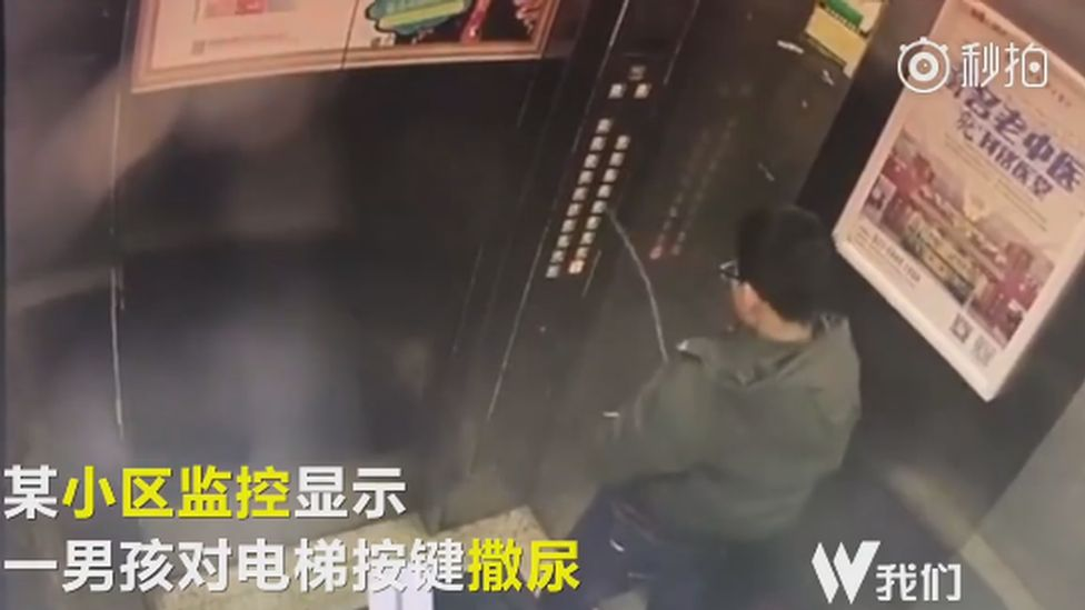 A boy peeing in a lift